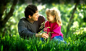 Father and daughter enjoying lawn - click here for information on organic products