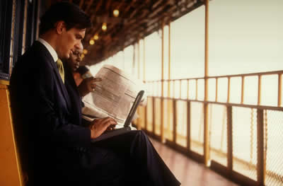 Laptop user & Newspaper Reader
